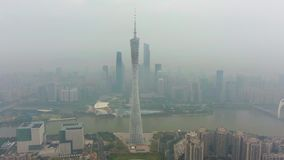 Guangzhou, China - March 25, 2018: Canton Tower and City Skyline in Smog in the Morning. Aerial View. Drone is Orbiting