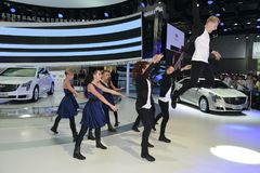 An amazing dance performance in the booth of Cadillac Stock Photos