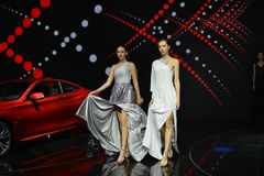 Fashion models in the booth of Infiniti. Guangzhou, China - November 18, 2017: Fashion models were in the booth of Infiniti in the 15th China Guangzhou Stock Photo
