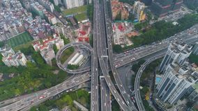 Guangzhou city and complex road interchange. Guangdong, China. Aerial view