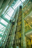 Guangzhou city library, Guangdong, china. This is the structure of the rapid elevator in the library. It is open and modern design. Transparent glass through stock photography