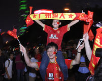 Guangzhou Evergrande win the AFC Champions League,Crazy fans. Guangzhou Evergrande became the first Chinese club to win the AFC Champions League,fans from around Stock Image