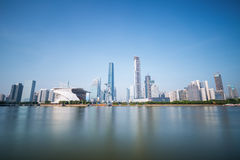 Guangzhou pearl river new town skyline in daytime. Long exposure of neutral density grey filter stock photography