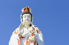 Guanine Buddha statue on blue sky, royalty free stock photography