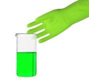 Guante verde y un tubo de ensayo Fotografía de archivo libre de regalías