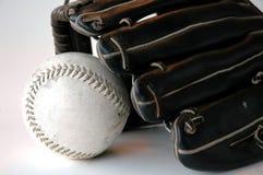 Guante y beísbol con pelota blanda Imágenes de archivo libres de regalías
