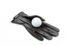 Guante y pelota de golf Fotografía de archivo