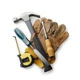 Guantes de cuero con las herramientas de la carpintería Imagen de archivo libre de regalías
