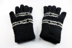 Guantes de la lana negra en el fondo blanco Imagenes de archivo