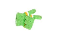 Guantes de lana hechos punto, símbolo de la dirección de los guantes del invierno Foto de archivo