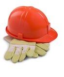 Guantes y casco protector Imagen de archivo