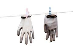 Guanti che appendono su una corda Immagine Stock