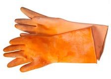 Guanti di gomma arancioni Fotografie Stock