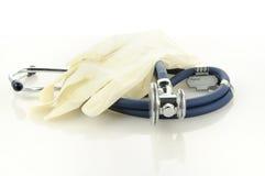 Guanti e phonendoscope medici Fotografia Stock