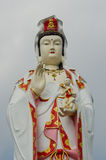 Guanyin with blue sky Stock Image