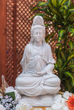 Guanyin. Bodhisattva statue. In the lotus position Royalty Free Stock Image