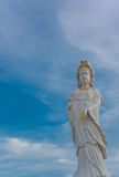 Guanyin Buddha statue on blue sky Royalty Free Stock Photos