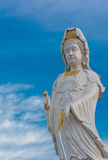 Guanyin Buddha statue on blue sky Royalty Free Stock Photo