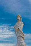 Guanyin Buddha statue on blue sky Stock Images