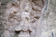 Guanyin Buddha in Wuyishan China. The Buddhist sea goddess, Guanyin, a small shrine within the Wuyishan or Mount wuyi scenic area in Wuyi China in fujian stock photography