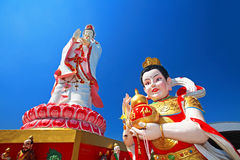 Guanyin, diosa de la misericordia, y dios del niño Imagenes de archivo