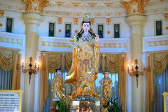 Guanyin or Kwannon statue. Guanyin is an East Asian deity of mercy, and a bodhisattva associated with compassion as venerated by Mahayana Buddhists. The name Stock Photography