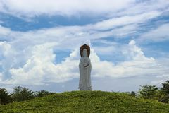 Guanyin statue against the background of the amazing cloudy sky stock photo
