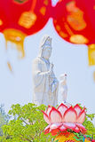 Guanyin statue, The Goddess of Compassion and Mercy. Statue of Guanyin Background sky Place Sathorn in Becket. Guanyin statue, The Goddess of Compassion and Royalty Free Stock Image