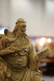Guanyu (?-220) woodcarving. In china, the generals are not reading. guan yu was not only good at fighting, but also fond of reading history books. chinese folk Stock Photos
