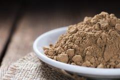 Guarana Powder. Portion of Guarana Powder on dark wooden background royalty free stock images