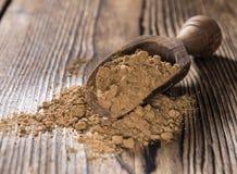 Guarana Powder. Portion of Guarana Powder on dark wooden background stock image