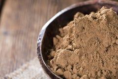 Guarana Powder. Portion of Guarana Powder on dark wooden background royalty free stock photo