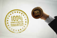 Guarantee a customer with a golden stamp Royalty Free Stock Photos