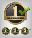 Guarantee gold label button set Royalty Free Stock Photo
