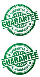 Guarantee Rubber Stamp - clean and grunge style. Rubber stamp style illustrations of the word Guarantee done in a clean and grunge style Stock Images