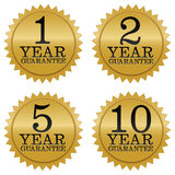 Guarantee Seals. A set of four golden guarantee seals. Covering one, two, five and ten years Stock Illustration