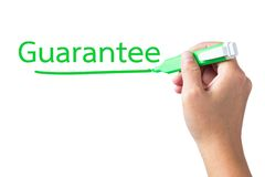 Guarantee topic. Hand underline Guarantee word on white background Stock Photo