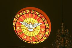 Stained glass with image of the Holy Spirit. Guararema; SP, Brazil - November 4, 2017 - Stained glass with image of the Holy Spirit, on the interior of the Stock Photography