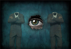 The Guard. Eye watches 2 headless man made of text Royalty Free Stock Photos