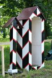 Guard booth and pillar with bell. In the forest stock photos