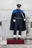 Guard Ceremonial Altar of the Fatherland in Rome (Victorian) with rifle. The guard of honor has a gun in his hand and a cloak and controls the shrine of the stock photography