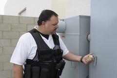 Guard Checking Padlock. Security guard checking the padlock Stock Images