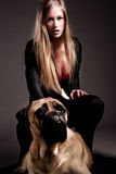 Guard dog and blond Stock Images
