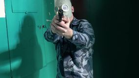 The guard, dressed in military uniform in the mask does not pass the man with the camera.  stock footage