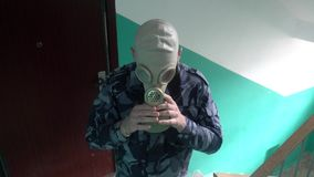 The guard, dressed in military uniform wearing a gas mask.  stock video footage