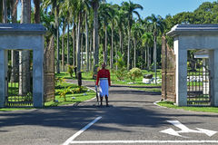 Guard on duty in front of the Parliament House in Suva, Fiji. The soldier has an interesting uniform with bright red top jacket and interesting white skirt Royalty Free Stock Photography