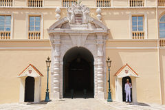 Guard on duty at the official residence of the Prince of Monaco in Monte Carlo, Monaco. MONTE CARLO, MONACO - JUNE 17, 2015: Guard on duty at the official stock photography