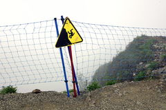 Guard Fence Equipment From Red Roupe Netting Befor Mountain Abys. Rope Guard Fence From Red Netting Before Abyss In The Mountains In Foggy And Storm Weather On Stock Photo