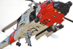 Guard Helicopter. US 102nd Civil Support Team in training excersise utilizing a US Coast Guard Helicopter, Sunriver Oregon, May 7, 2007 Royalty Free Stock Image