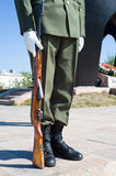 Guard of honor. Soldier of guard of honor with carbine by military monument Royalty Free Stock Images